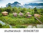 village and mountain in vang... | Shutterstock . vector #303638720