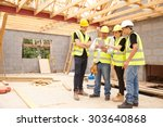 builder on site looking at... | Shutterstock . vector #303640868