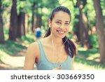 portrait running young woman.... | Shutterstock . vector #303669350