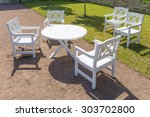 white round table and chairs in ... | Shutterstock . vector #303702800