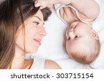Happy Baby Girl Lying Near Her...