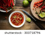 Stock photo thai fish sauce in a cup on wood background top view asian meal concept 303718796