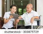 female nurse discussing over...   Shutterstock . vector #303875729