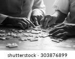 elder care nurse playing jigsaw ... | Shutterstock . vector #303876899