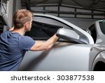 applying tinting foil on a car... | Shutterstock . vector #303877538