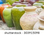 Row Of Clay Colorful Pot On Th...