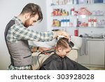 hairdresser cuts hair with... | Shutterstock . vector #303928028