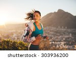 Female Runner Running Outdoor...