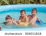 children swim in the pool and... | Shutterstock . vector #304011818