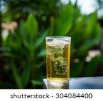 glass of beer standing on table ... | Shutterstock . vector #304084400