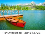Red Wooden Boats On Mountain...