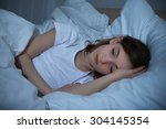 innocent girl in bedroom having ... | Shutterstock . vector #304145354