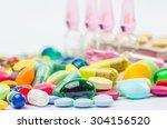 ampoule and pills shot | Shutterstock . vector #304156520