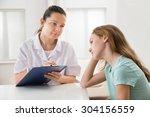female doctor comforting... | Shutterstock . vector #304156559