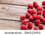 Red Raspberries On Grey Wooden...