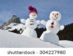 Funny Snowmen Against Swiss Alps
