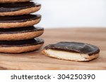 slice of jaffa cake with pile... | Shutterstock . vector #304250390