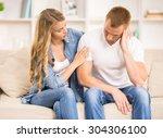 upset man sitting on sofa at... | Shutterstock . vector #304306100