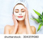 Spa Woman Applying Facial...