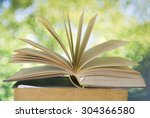 open book on blurred nature... | Shutterstock . vector #304366580