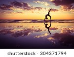 silhouette of woman practicing... | Shutterstock . vector #304371794