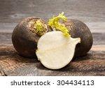 black radish on wooden...   Shutterstock . vector #304434113