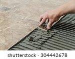 man placing ceramic floor tile... | Shutterstock . vector #304442678