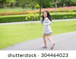 Happy Asian Girl Running In Th...