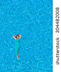 woman floating in the swimming... | Shutterstock . vector #304482008