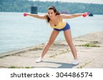 beautiful girl doing exercise... | Shutterstock . vector #304486574