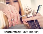 close up of a hairdresser... | Shutterstock . vector #304486784