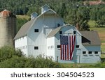 White Barn With An American...