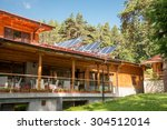 solar panel on a red roof  | Shutterstock . vector #304512014