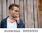 young handsome man smoking... | Shutterstock . vector #304534553