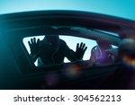 Car Robber Concept Photo. Robber Looking Thru Car Window. Carjacking Theme. - stock photo