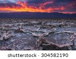 Small photo of Fiery sunset over Badwater, the lowest point in the United States, California's Death Valley National Park.