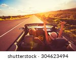 happy young couple driving... | Shutterstock . vector #304623494