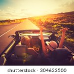 happy young couple driving... | Shutterstock . vector #304623500