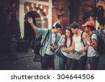 multiracial friends tourists... | Shutterstock . vector #304644506