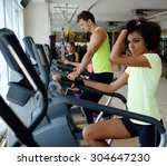 people exercising on a cardio... | Shutterstock . vector #304647230