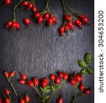 Rose Hips Berries On Dark Slat...