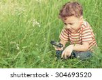 happy little boy exploring... | Shutterstock . vector #304693520