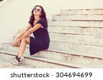 stylish young woman standing by ... | Shutterstock . vector #304694699