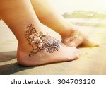henna tattoo on the foot.... | Shutterstock . vector #304703120