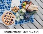 cozy picnic near lake   Shutterstock . vector #304717514