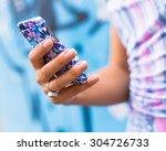 Female Hands Holding Smartphon...