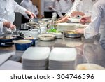 team of restaurant chef helping ... | Shutterstock . vector #304746596