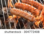 grilling sausages over flames...