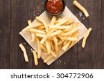 french fries with ketchup on... | Shutterstock . vector #304772906