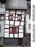 Skewed Half Timbered House In...